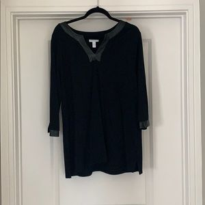 Knit top with faux leather neckline and sleeves